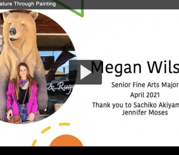 Picture of a young woman with a large carved bear looming behind her, the words Megan wilson appear in the space next to the picture, links to video