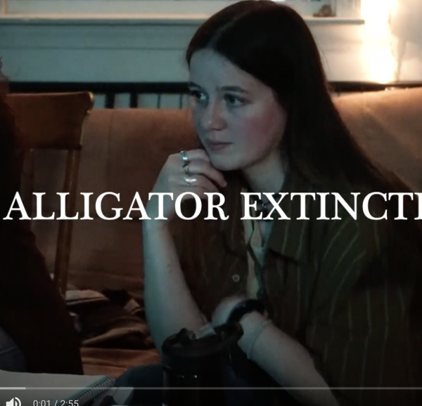 Picture of a seated young woman with the words alligator extinction