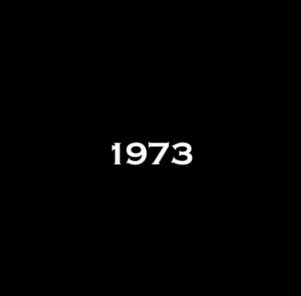 black screen with the number 1973 in the center