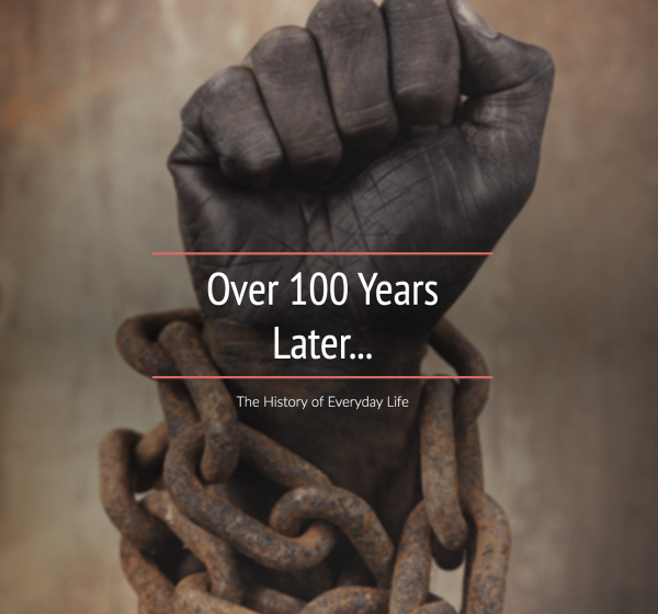 picture of a raised fist with a dark skin tone, chains are wrapped around the wrist