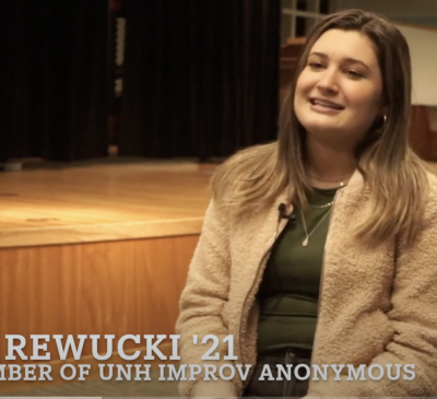 picture of a girl with brown hair smiling improv club is written at the bottom